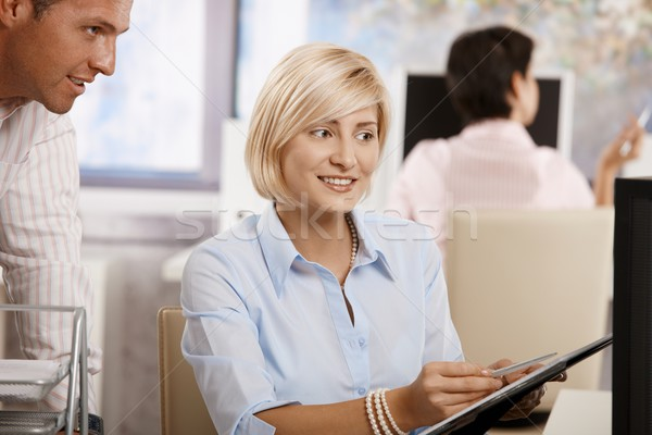 Businesswoman working in office Stock photo © nyul