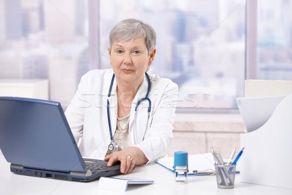 Stock photo: Senior doctor using laptop computer