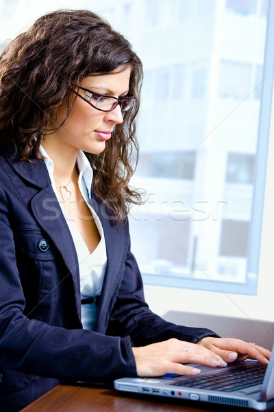 Stock photo: Businesswoman working on computer