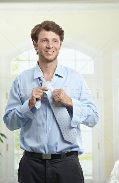 Businessman fastening tie Stock photo © nyul