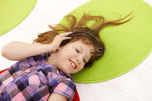 Portré iskolás lány headset zenét hallgat mosolyog magasról fotózva Stock fotó © nyul