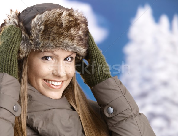 Young woman dressed up for winter fun smiling Stock photo © nyul