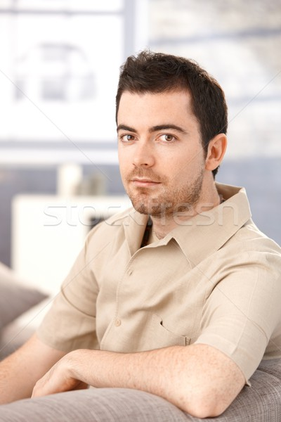 Portrait of young man sitting in living room Stock photo © nyul
