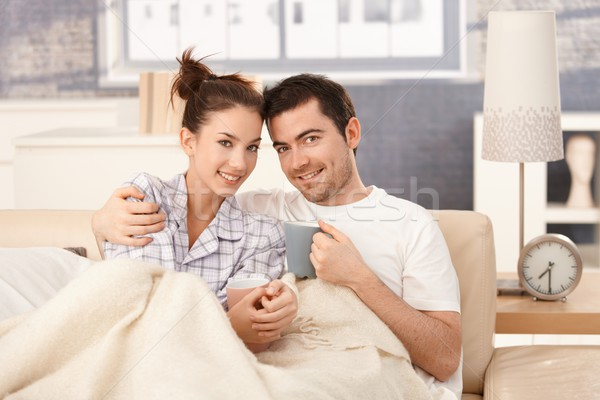 Young couple drinking tea in bed smiling happily Stock photo © nyul