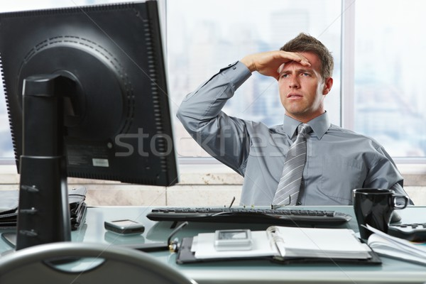Businessman looking at screen in office Stock photo © nyul