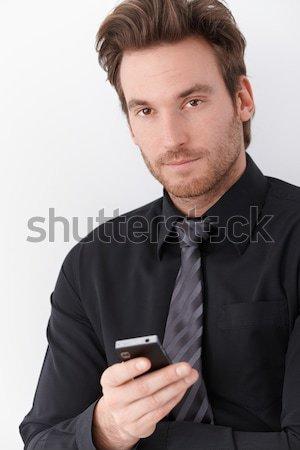 Portrait jeunes affaires élégant téléphone portable affaires Photo stock © nyul
