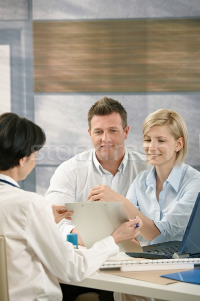 Couple discussing results with physician Stock photo © nyul