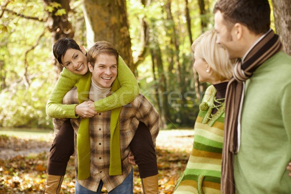 Two couples having fun in autumn park Stock photo © nyul