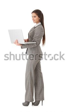 Női lezser irodai dolgozó laptop vonzó nő laptopot használ Stock fotó © nyul