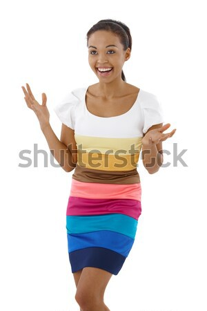 Happy surprised girl in multicolour dress Stock photo © nyul