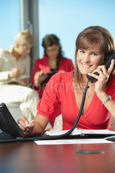 Businesswoman talking on landline phone Stock photo © nyul