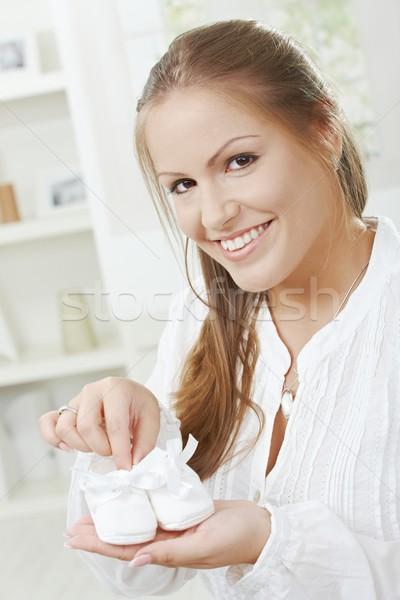 妊婦 興奮した 妊娠 ベビーシューズ 新しい ストックフォト © nyul
