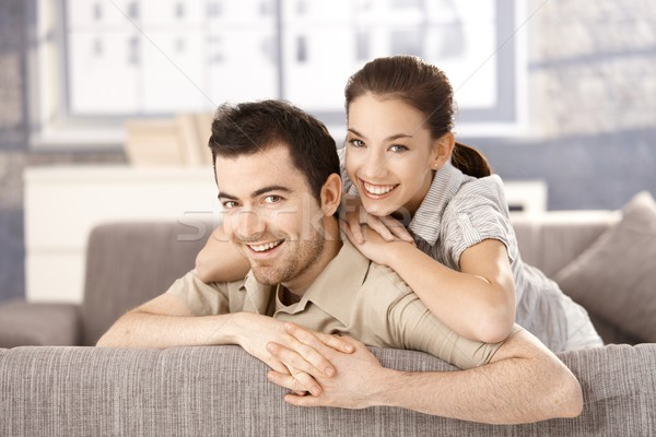 Young couple smiling happily on sofa at home Stock photo © nyul