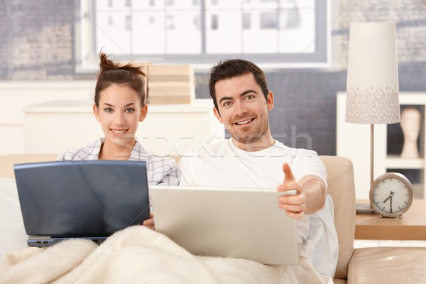 Happy couple browsing internet in bed at home Stock photo © nyul