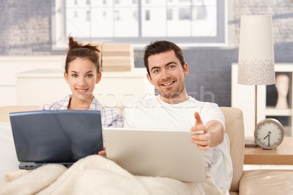 счастливым пару интернет кровать домой Сток-фото © nyul