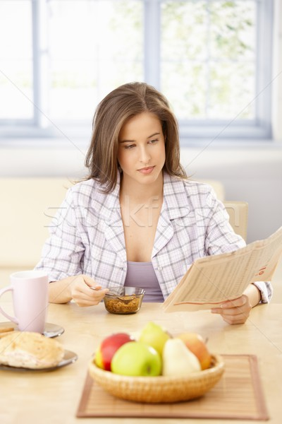 Woman reading papers at breakfast Stock photo © nyul
