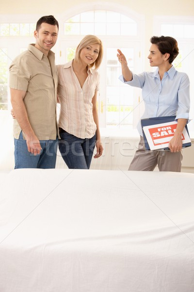 Estate agent showing around couple Stock photo © nyul