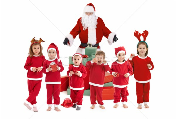 Stock photo Santa Claus and happy little children preparing for Christmas children wearing Santa costume.  sc 1 st  Stockfresh & Santa Claus with happy little children in costume stock photo ...