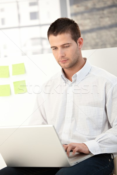 Casual office worker using laptop Stock photo © nyul