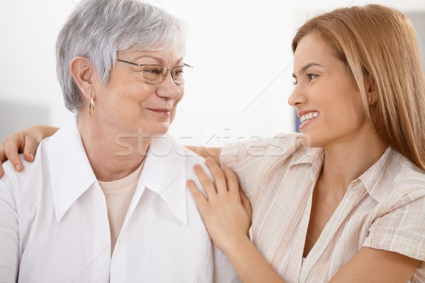 Young woman hugging mother smiling Stock photo © nyul