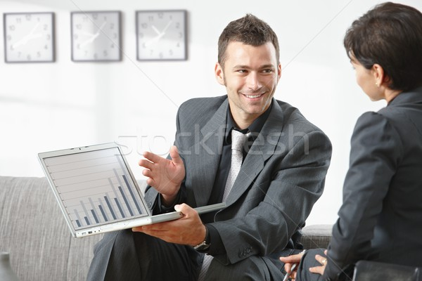 Stock photo: Businessman showing grapth on computer