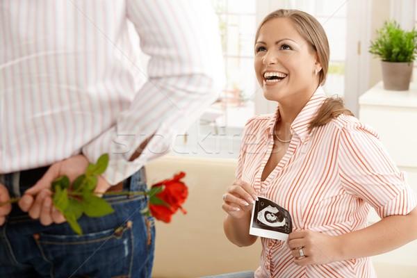 смеясь беременная женщина цветы ультразвук ребенка фотография Сток-фото © nyul