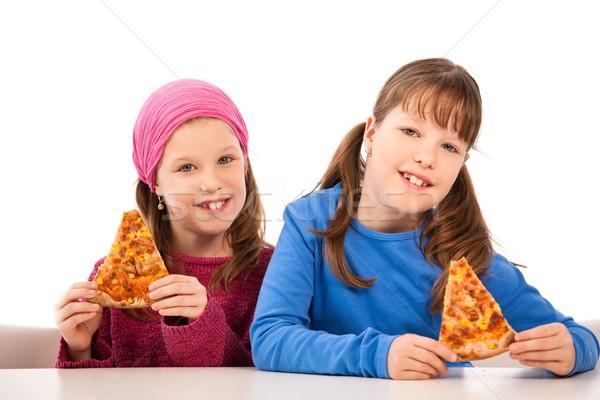 Lányok pizza mosolyog asztal eszik szeletek Stock fotó © nyul