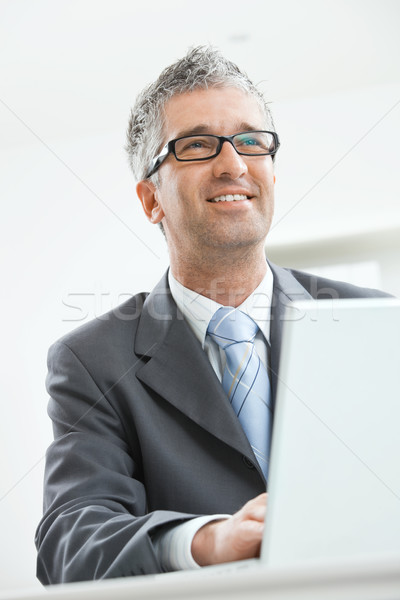 Businessman working at desk Stock photo © nyul
