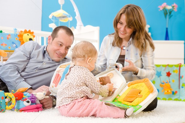 счастливая семья играет вместе матери отец 1 год Сток-фото © nyul
