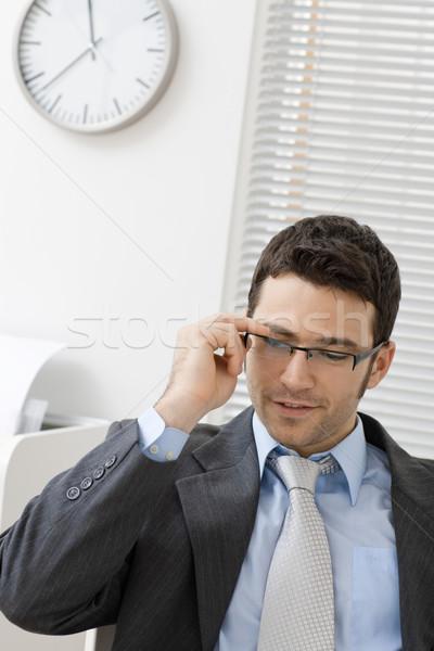 Businessman taking off glasses Stock photo © nyul