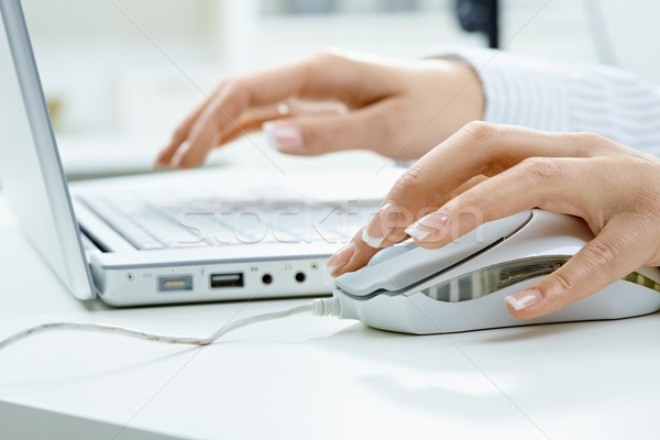 Stock photo: Female hand using computer mouse