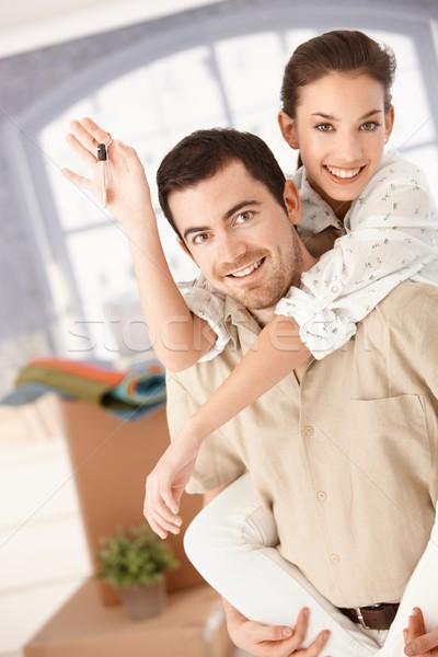 Happy couple moving house smiling Stock photo © nyul