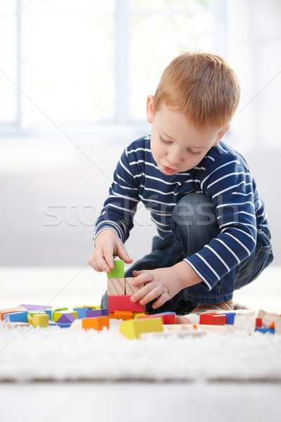 Ginger-haired little boy playing at home Stock photo © nyul