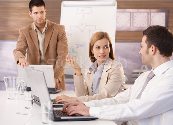 Young businesswoman and team at meeting Stock photo © nyul
