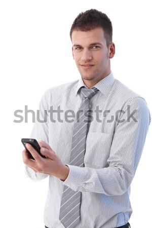 Guapo empresario móviles jóvenes teléfono móvil escrito Foto stock © nyul