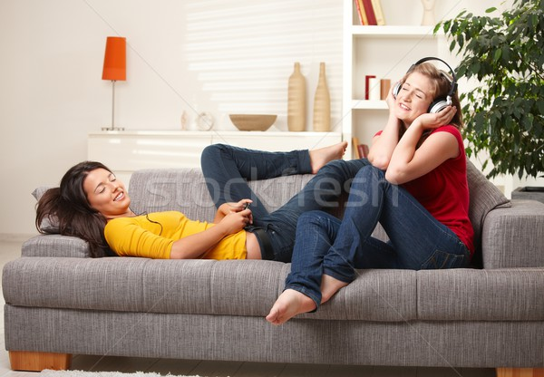Teen girls listening to music on couch Stock photo © nyul