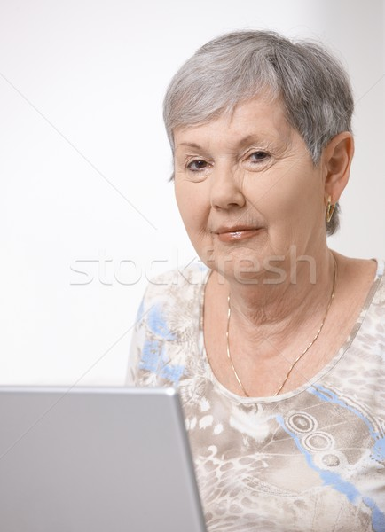Stock photo: Senior woman using laptop computer