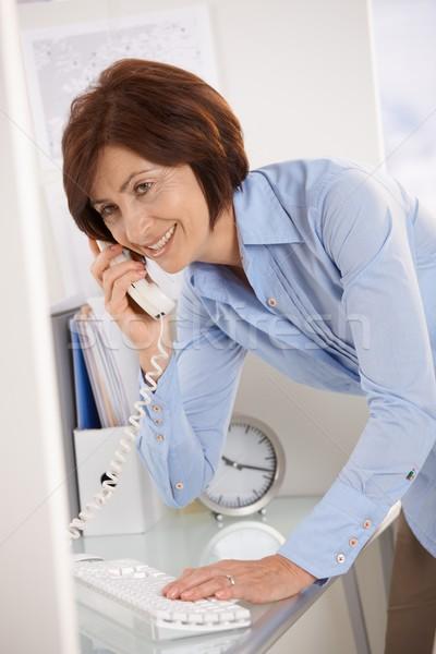 Senior businesswoman on landline phone call Stock photo © nyul