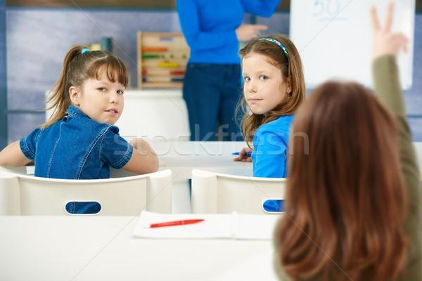 Сток-фото: школьницы · сидят · столе · классе · обучения