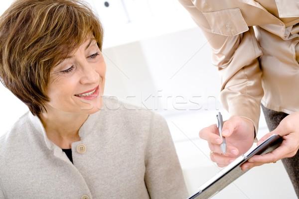 Senior businesswomen reviewing document Stock photo © nyul