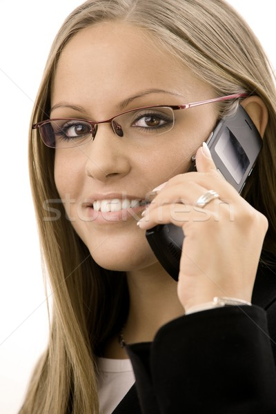 Businesswoman calling on mobile Stock photo © nyul