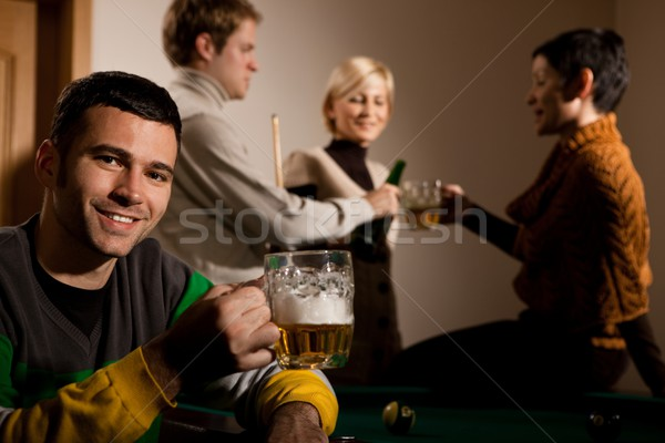Portrait of man drinking beer at snooker Stock photo © nyul