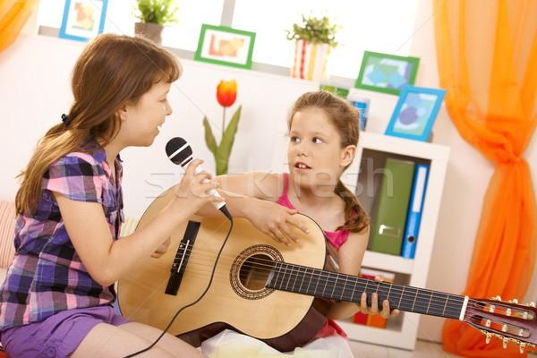 Lányok játszik zene énekel alapfokú kor Stock fotó © nyul
