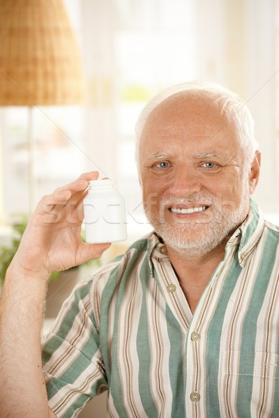Older man presenting medication Stock photo © nyul