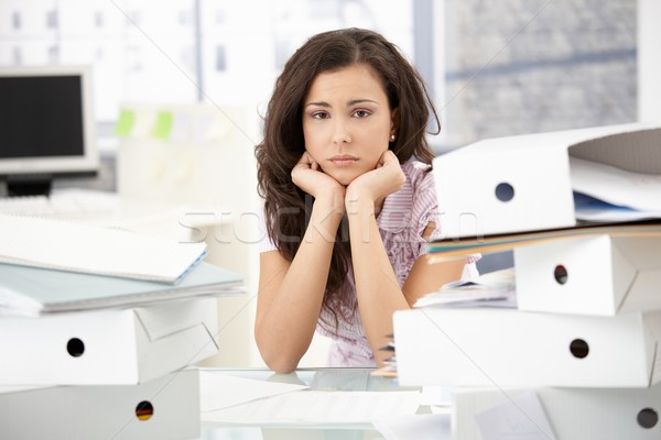 Young office worker sitting troubled in office Stock photo © nyul