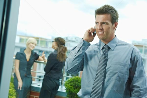 Zakenman mobiele telefoon zakenlieden praten terras outdoor Stockfoto © nyul