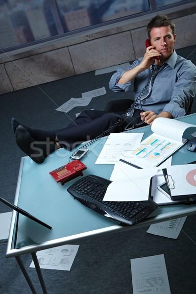 Сток-фото: бизнесмен · вызова · ног · вверх · документы