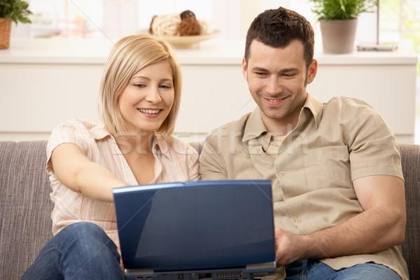 Couple browsing internet on laptop Stock photo © nyul