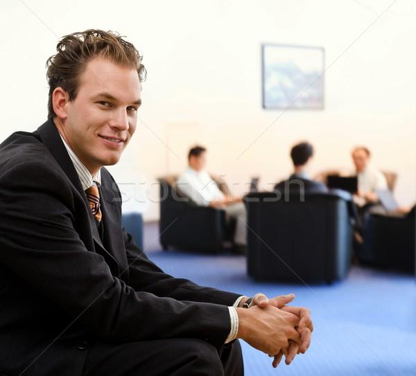 ビジネスマン オフィス ロビー 幸せ 座って 笑みを浮かべて ストックフォト © nyul