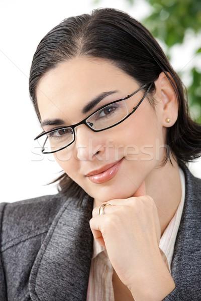Portrait of thinking businesswoman Stock photo © nyul